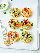 Frittata muffins with bacon, tomatoes, mushrooms and zucchini