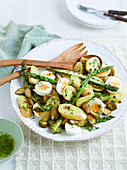 Potato salad with asparagus, eggs and gherkins