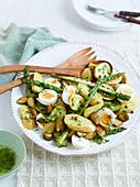 Potato salad with asparagus, eggs and gherkins