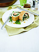 Pancake roulade filled with spinach and eggs