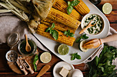 Grilled corn on the cob with herb butter and limes