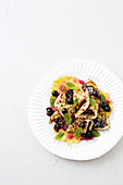 Spicy calamari with pineapple, blueberry and mint salad
