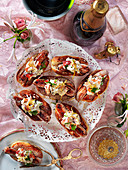 Hot dogs with lobster and lemon zest for a New Year's Eve party