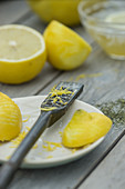 A zester with lemon zest and bergamot