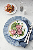 Oven-roasted lamb fillet with a herb sauce
