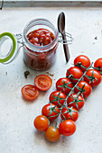 Tomato sauce in a glass and fresh cherry tomatoes