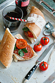 Sandwiches with cream cheese, salami, tomatoes and parsley, with a glass of cola