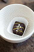 A Petit Four with chocolate and nib sugar