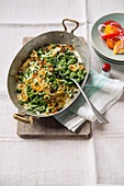 Cheese egg pasta with stinging nettles and red onions