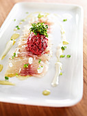 Marinated whitefish with beetroot tartare and sour cream