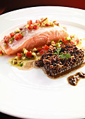 Salmon medallions with lardo, lentils and cornichons