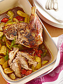 Shoulder of lamb on a bed of braised cucumber and tomatoes