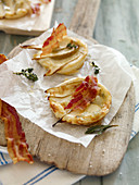 Pear and gorgonzola tartes with crispy bacon