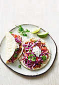 Spicy steak tacos with smashed kidney beans