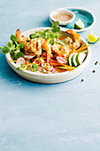 Barbecue salt and pepper prawns with avocado and snow pea sprouts