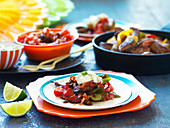 Lamb fajitas with tomato salsa, jalapeno sour cream