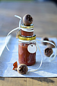 Homemade medlar mousse in screw-top jar as gifts