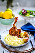 Duck leg with mashed potatoes and apple