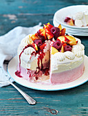 Peach Melba ice cream cake with raspberries, sliced