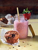 A strawberry smoothie and a muffin for brunch
