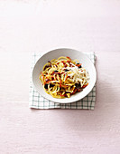 Potato pasta with olives, dried tomatoes and Parmesan
