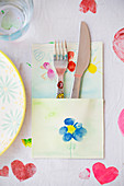 Cutlery pouch painted with colourful flowers for child's birthday party
