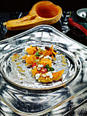 Butternut squash with lentil and chili vinaigrette and hazelnuts