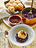 Buchteln (sweet bread dumplings) with red cabbage and salted chocolate crumbs