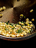 Diced kohlrabi being fried in butter