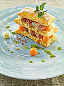 Melon puff pastry tower with chocolate mousse and mint oil
