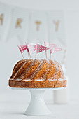 A classic Bundt cake decorated with flags for a party