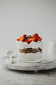 Yoghurt with granola, chia seeds and strawberries