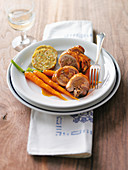 Chicken leg roulade with napkin dumplings and carrots