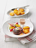 Beef fillet with glazed vegetables with potato fritters