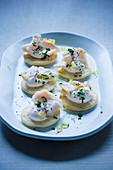 Blinis with smoked fish and sour cream