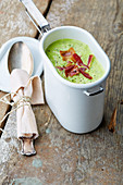 Courgette soup with bacon chips to take away