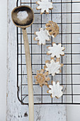 Iced flower-shaped cinnamon biscuits on a wire rack