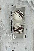 Coconut macaroons with chocolate glaze in a box