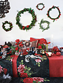 Wreaths above table festively set in red and black