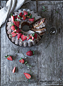 A chocolate wreath cake with bananas and strawberries (seen from above)