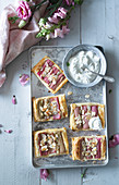 Rhubarb and puff pastry slices with cream (seen from above)
