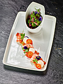 Herb salad with crayfish and white tomato mousse