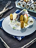 Rollmops with apple, onions and gherkins