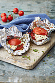 Mediterranean sheep's cheese with tomatoes baked in foil