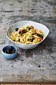 Warm spanish pasta salad with olives