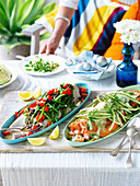 Fish with nicoise salsa and Ocean trout with asparagus, fennel and dill