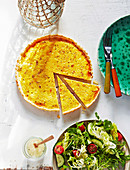Quiche lorraine with simple greek salad