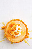 Papaya and coconut tart with ginger syrup