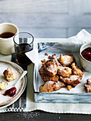 Rice pudding fritters with rhubarb and strawberry jam