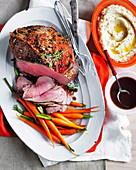 Roast beef with red wine gravy, Honeyed Dutch carrots, and celeriac puree